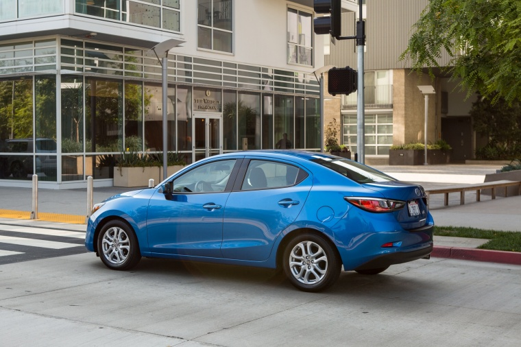 2016 Scion iA Sedan in Sapphire from a rear left three-quarter view
