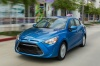 Driving 2016 Scion iA Sedan in Sapphire from a front left view