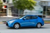 Driving 2016 Scion iA Sedan in Sapphire from a front left three-quarter view