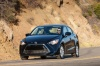 Driving 2016 Scion iA Sedan in Abyss from a front left view