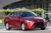 Driving 2016 Scion iA Sedan in Pulse from a front right three-quarter view