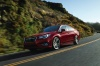 Driving 2018 Subaru Legacy 3.6R in Crimson Red from a front left three-quarter view