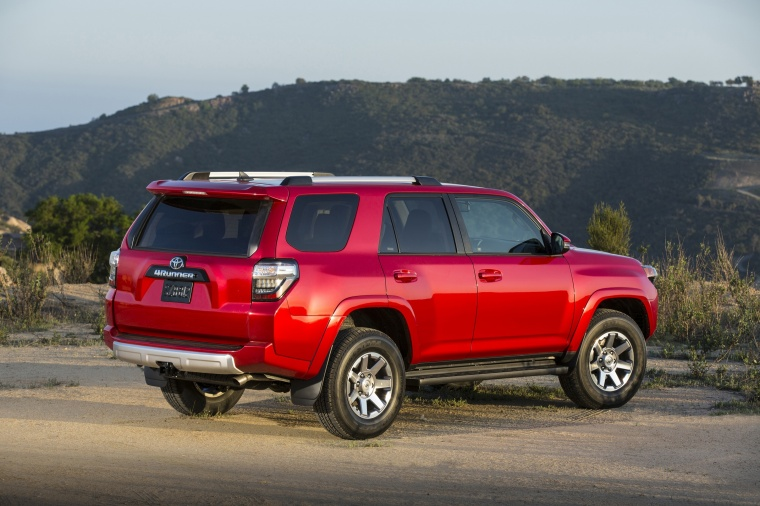 Picture of a 2016 Toyota 4Runner Trail in Barcelona Red Metallic from a rear right three-quarter perspective