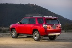 Picture of a 2016 Toyota 4Runner Trail in Barcelona Red Metallic from a rear left three-quarter perspective