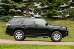 Picture of a driving 2016 Toyota 4Runner SR5 in Midnight Black Metallic from a side perspective