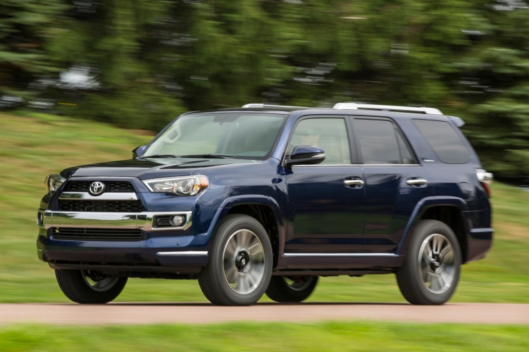 Picture of a driving 2017 Toyota 4Runner Limited in Nautical Blue Pearl from a front left three-quarter perspective