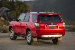 Picture of a 2017 Toyota 4Runner TRD Off Road in Barcelona Red Metallic from a rear left perspective