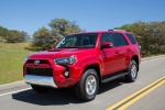 Picture of a driving 2017 Toyota 4Runner TRD Off Road in Barcelona Red Metallic from a front left three-quarter perspective