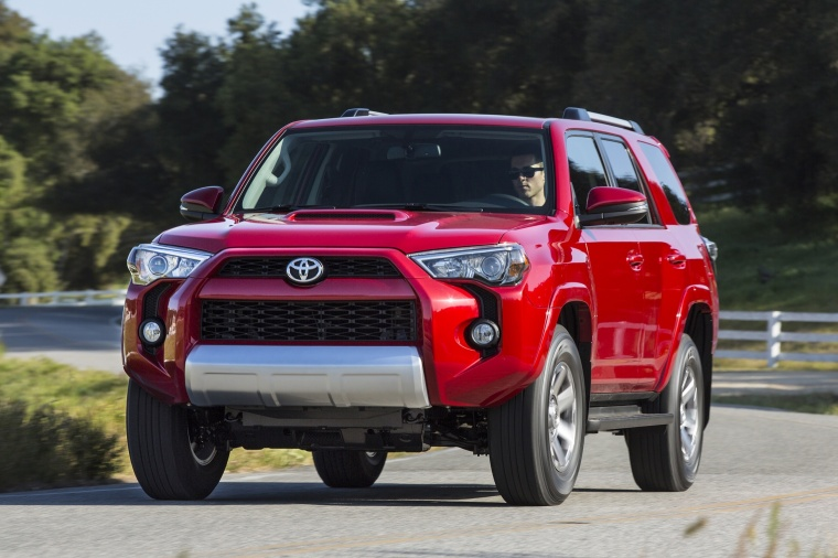 Driving 2018 Toyota 4Runner TRD Off Road in Barcelona Red Metallic from a front left view