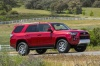 Driving 2018 Toyota 4Runner TRD Off Road in Barcelona Red Metallic from a front right three-quarter view