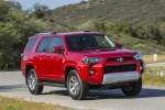 Picture of a driving 2019 Toyota 4Runner TRD Off Road in Barcelona Red Metallic from a front right perspective