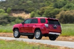 Picture of a driving 2019 Toyota 4Runner TRD Off Road in Barcelona Red Metallic from a rear left three-quarter perspective