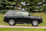 Picture of a driving 2019 Toyota 4Runner SR5 in Midnight Black Metallic from a side perspective
