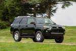Picture of a driving 2020 Toyota 4Runner SR5 in Midnight Black Metallic from a front right three-quarter perspective
