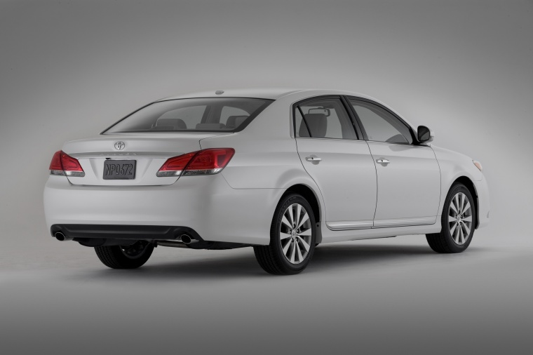 2011 Toyota Avalon in Blizzard Pearl from a rear right three-quarter view