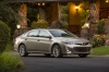 2014 Toyota Avalon Limited in Creme Brulee Mica from a front right three-quarter view