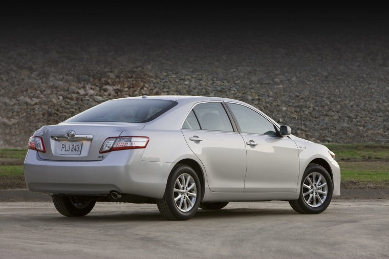 2010 Toyota Camry Hybrid in Classic Silver Metallic from a rear three-quarter view