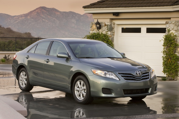 2010 Toyota Camry LE in Magnetic Gray Metallic from a front three-quarter view