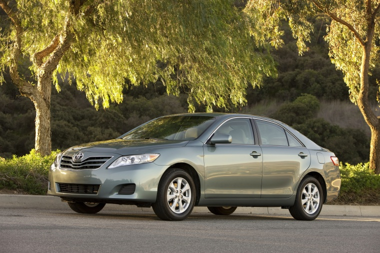 2010 Toyota Camry LE in Magnetic Gray Metallic from a front left view