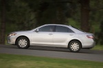 2010 Toyota Camry Hybrid in Classic Silver Metallic - Driving Left Side View