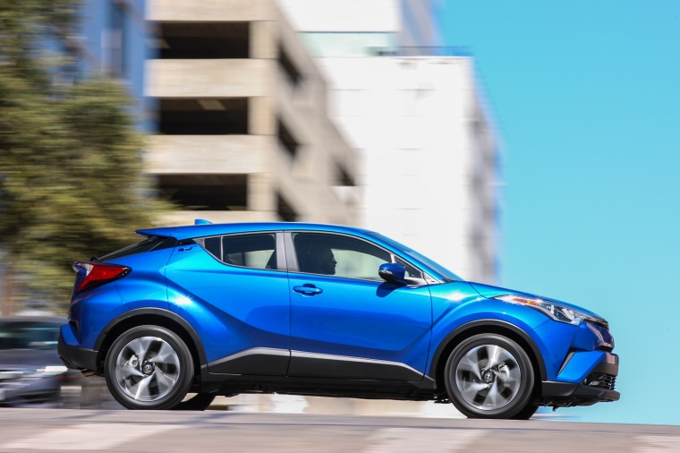 Driving 2018 Toyota C-HR in Blue Eclipse Metallic from a side view