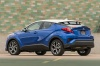 2018 Toyota C-HR in Blue Eclipse Metallic from a rear left three-quarter view