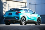 Picture of a 2018 Toyota C-HR in Radiant Green Mica from a rear right three-quarter perspective