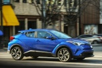 Picture of a driving 2018 Toyota C-HR in Blue Eclipse Metallic from a front right three-quarter perspective