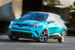 Picture of a driving 2018 Toyota C-HR in Radiant Green Mica from a front left perspective