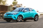 Picture of a driving 2018 Toyota C-HR in Radiant Green Mica from a front left three-quarter perspective