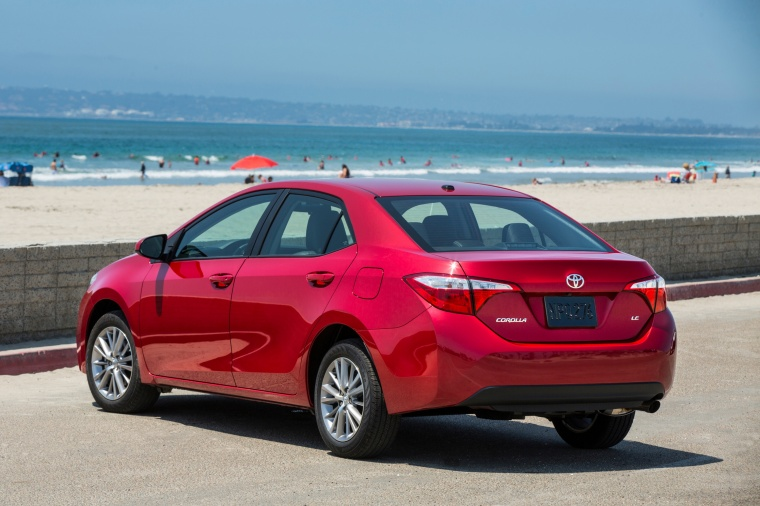 2014 Toyota Corolla LE in Barcelona Red Metallic from a rear left view