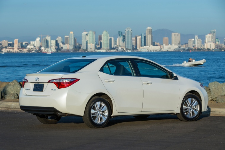2016 Toyota Corolla LE Eco in Blizzard Pearl from a rear right three-quarter view