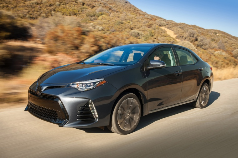 Driving 2017 Toyota Corolla XSE in Falcon Gray Metallic from a front left three-quarter view