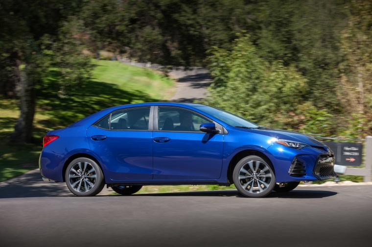 Driving 2017 Toyota Corolla SE in Blue Crush Metallic from a right side view