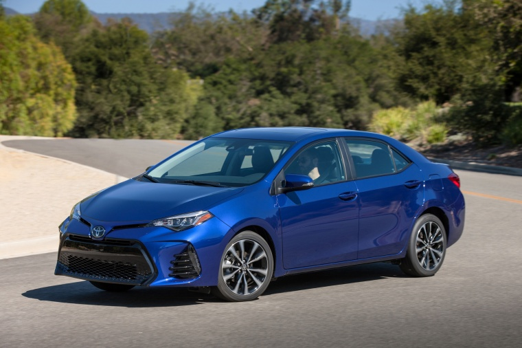 Driving 2017 Toyota Corolla SE in Blue Crush Metallic from a front left three-quarter view