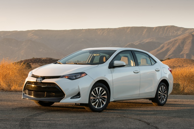 2017 Toyota Corolla LE Eco in Blizzard Pearl from a front left three-quarter view