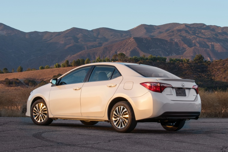 2017 Toyota Corolla LE Eco in Blizzard Pearl from a rear left three-quarter view