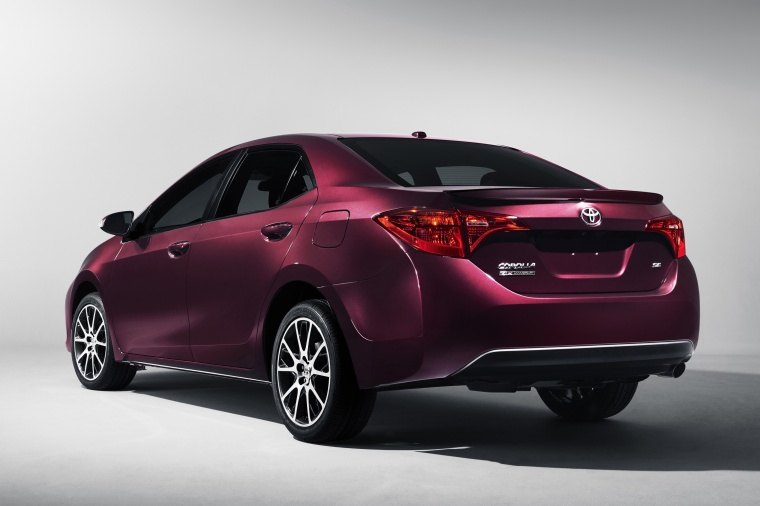 2017 Toyota Corolla 50th Anniversary Special Edition in Black Cherry Pearl from a rear left view