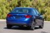 Driving 2017 Toyota Corolla SE in Blue Crush Metallic from a rear right view
