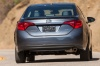 Driving 2017 Toyota Corolla XSE in Falcon Gray Metallic from a rear view