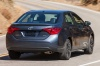 Driving 2017 Toyota Corolla XSE in Falcon Gray Metallic from a rear right view