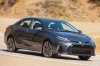 Driving 2017 Toyota Corolla XSE in Falcon Gray Metallic from a front right three-quarter view