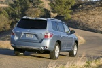 2010 Toyota Highlander Hybrid in Wave Line Pearl - Driving Rear Right Three-quarter View