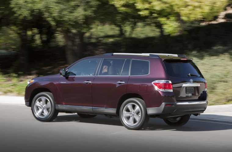 2013 toyota highlander limited v6 in sizzling crimson mica color driving rear left three. Black Bedroom Furniture Sets. Home Design Ideas