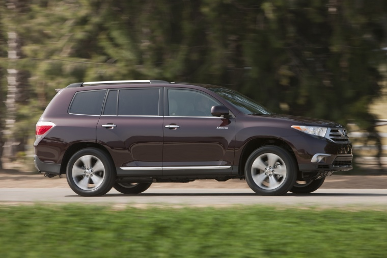 2013 toyota highlander limited v6 in sizzling crimson mica color driving right side view. Black Bedroom Furniture Sets. Home Design Ideas