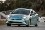 2018 Toyota Prius Three in Sea Glass Pearl - Driving Front Left View