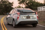 2018 Toyota Prius Three in Sea Glass Pearl - Driving Rear Left View