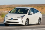 2018 Toyota Prius Two in Super White - Driving Front Left Three-quarter View