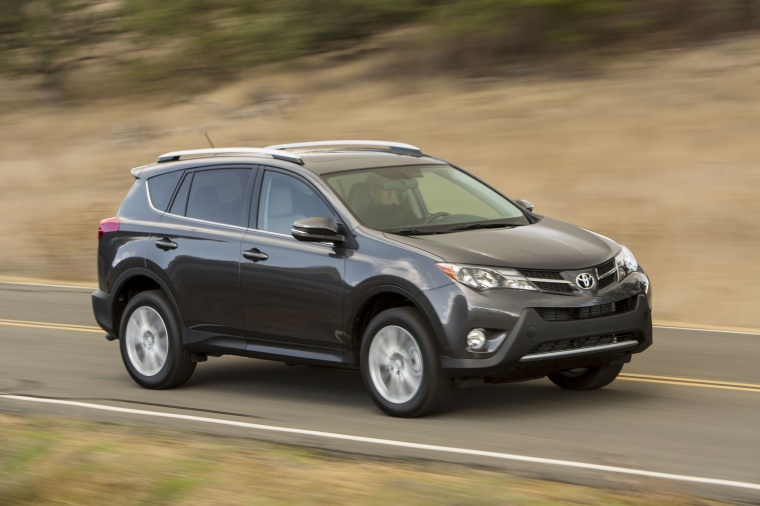 Picture of a driving 2014 Toyota RAV4 Limited in Magnetic Gray Pearl from a front right three-quarter perspective