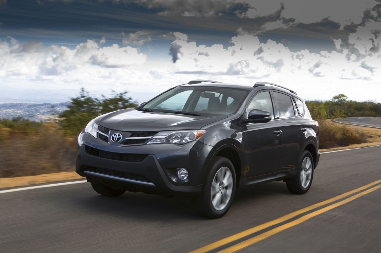 Picture of a driving 2014 Toyota RAV4 Limited in Magnetic Gray Pearl from a front left perspective